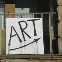 handpainted sign on railings saying... art